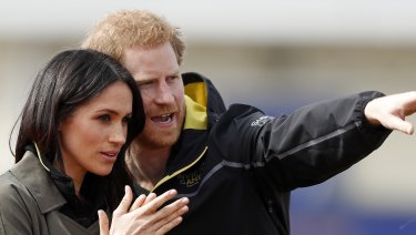 Britain's Prince Harry and his fiancee Meghan Markle attend the UK team trials for the Invictus Games in Sydney at the University of Bath in Bath, England.