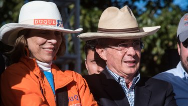 Alvaro Uribe, former president of Colombia, right, attends the closing campaign rally of Ivan Duque.