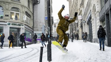 A snowboarder makes the most of it in Lausanne, Switzerland.