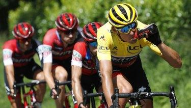 Belgium's Greg van Avermaet dons the yellow jersey during stage five.