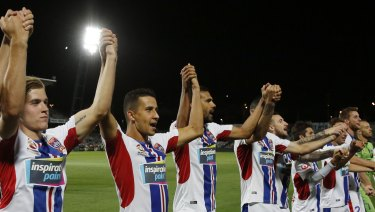 Back to form: The Jets players thanks their travelling supporters.