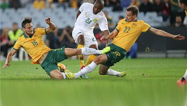 Socceroos clash with South Africa in the 2014 World Cup farewell game.