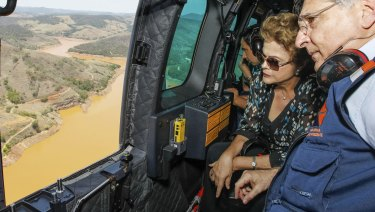 Then Brazilian president Dilma Rousseff inspects the environmental damage to the Vale River after the Samarco disaster.