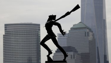 Buildings in Lower Manhattan provide a backdrop to a statue dedicated to the victims of the Katyn massacre of 1940, in Jersey City, New Jersey.