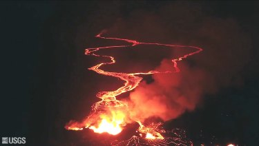 Lava flows from a Kilauea Volcano fissure into the ocean, top, near the town of Pahoa, Hawaii.