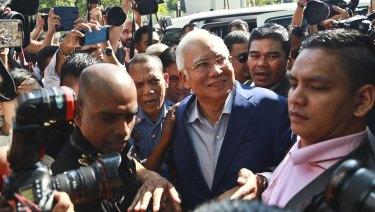 Summoned: former Malaysian PM Najib Razak, centre, arrives at Malaysian Anti-Corruption Commission (MACC) in Putrajaya, Malaysia.