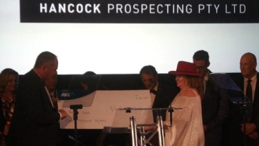 Former deputy prime minister and agriculture and water resources minister Barnaby Joyce receives a $40,000 cheque frommining and agricultural magnate Gina Rinehart