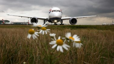 A passenger aircraft operated by British Airways waits to take off from London Heathrow airport.