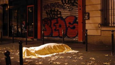 A victim under a blanket lays dead outside the Bataclan theatre in Paris in November 2015.