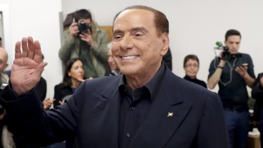 Italian former premier and leader of Forza Italia party Silvio Berlusconi waves at a polling station in Milan, Italy.