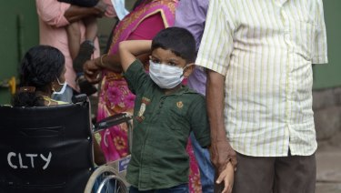 An Indian boy wears a mask as a precautionary measure against the Nipah virus.