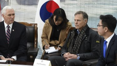 US. Vice President Mike Pence, left, talks with North Korean defector Ji Seong-ho, right, as Fred Warmbier, the father of Otto Warmbier, an American who died after being held in North Korea, listens at the Cheonan Memorial in Pyeongtaek, South Korea in February.