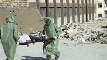 Syrians in protective suits and gas masks conduct a drill on how to treat casualties of a chemical weapons attack in Aleppo in 2013.