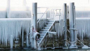 Ice covers the pier at the harbour of Constance at lake Constance, Germany.