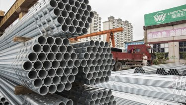 Bundles of steel pipe sit stacked at a stockyard on the outskirts of Shanghai, China. Trump's attempts to re-balance global trade have already sent the metals world into a tizzy, and the disarray is set to increase.