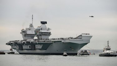 The HMS Queen Elizabeth, the British navy's newest and most expensive aircraft carrier, will be accompanied by Australian navy ships through the South China Sea.