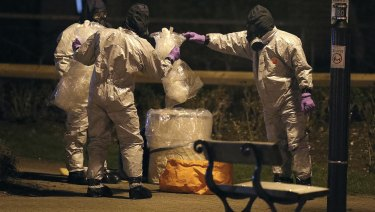 Investigators in protective suits work in Salisbury, England, on Tuesday.