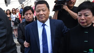 BillionaireNgLapSeng, centre, exits the federal court in New York on Friday.