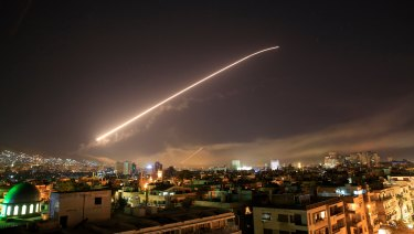 The Damascus sky lights up missile fire as the US or France or the UK launches an attack on Syria targeting different parts of the capital in April 14.