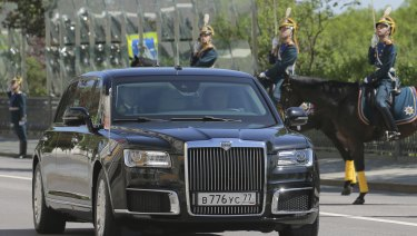 For the first time, Putin rode in a limousine made in Russia rather than a German-made Mercedes.