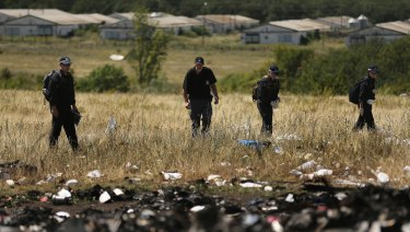 Australian Federal Police and their dutch counterparts search the MH17 crash site for human remains in 2014.