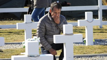 he relative of an Argentinian soldier visits the Darwin Military Cemetery on Falkland, or Malvinas Islands, after the tombs were finally named.