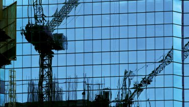 Cranes dominate the city landscape.