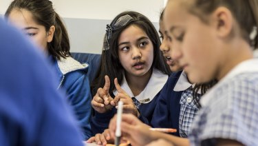 Sana Rezae, 11, sits with other year six students from Merrylands East Primary School, where they work together in groups.
