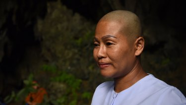 Buddhist nun Dao in the Tham Pra cave shrine where people are praying for the safe return of the trapped 13.