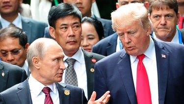 Donald Trump and Vladimir Putin talk at the APEC Summit last year.