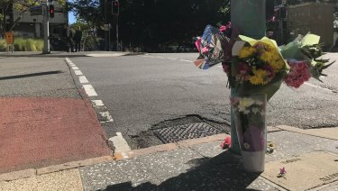 Flowers have been laid at the intersection between Ann and Wharf streets where a woman died after she was hit by a bus on Tuesday.