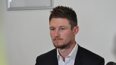 Cameron Bancroft addresses media after arriving back in Perth from South Africa.
