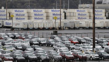 New cars and cargo containers wait in Tacoma, Washington.