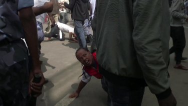 People fall over in the rush to get away, after an explosion at a rally for Ethiopia's new Prime Minister, in Addis Ababa on Saturday.