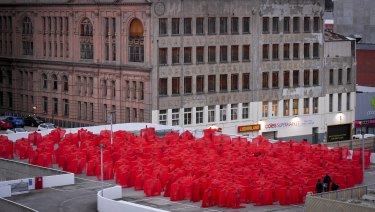 A sea of red as hundreds pose nude for Spencer Tunick