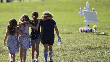 Children console each other after the shooting at Marjory Stoneman Douglas High.