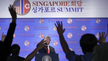US President Donald Trump answers questions about the summit with North Korea leader Kim Jong-un during a press conference at the Capella Hotel in Singapore.