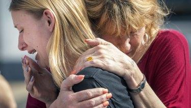 Santa Fe High School student Dakota Shrader is comforted by her mother.
