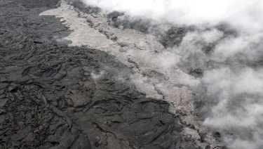 A lava flow (lighter in colour) and spatter that erupted from a section of the crack on the west flank of Puu Oo vent of Kilauea Volcano in Hawaii.