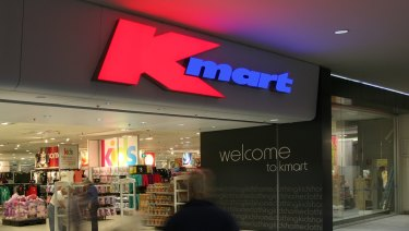 Kmart's new staff set for lower pay in union plan