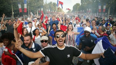 The celebrations begin on the Champs Elysees.