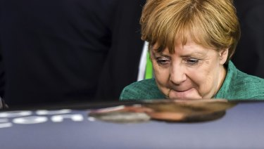 German Chancellor Angela Merkel leaves the EU summit in Brussels, early on Friday.