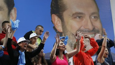 Supporters of Lebanese Prime Minister Saad Hariri cheer at a rally this week.