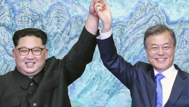 North Korean leader Kim Jong-un, left, and South Korean President Moon Jae-in raising their hands after signing a joint statement at the border village of Panmunjom in the Demilitarized Zone, South Korea.