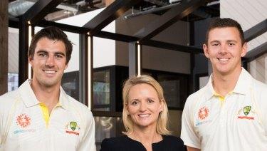 Domain's Melina Cruickshank (centre) with cricketers Pat Cummins (left) and Josh Hazelwood.