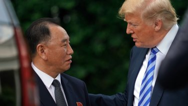 President Donald Trump talks with Kim Yong Chol, left, former North Korean military intelligence chief and one of leader Kim Jong Un's closest aides.