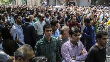 A group of protesters chant slogans at the old grand bazaar in Tehran, Iran.