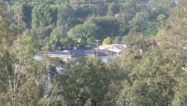Lyn Lynch's Fernvale home at the height of the 2011 flood.