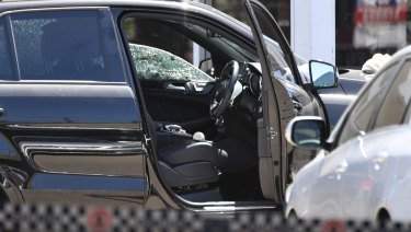 A bullet hole in the window of the Mercedes-Benz SUV in which Mick Hawi was shot.