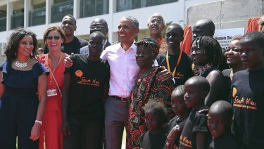 Barack Obama, centre, with his step Grandmother Sarah, centre right, his half sister Auma, third right, along with children and  officials, during an event in Kogelo, Kenya, on Monday.